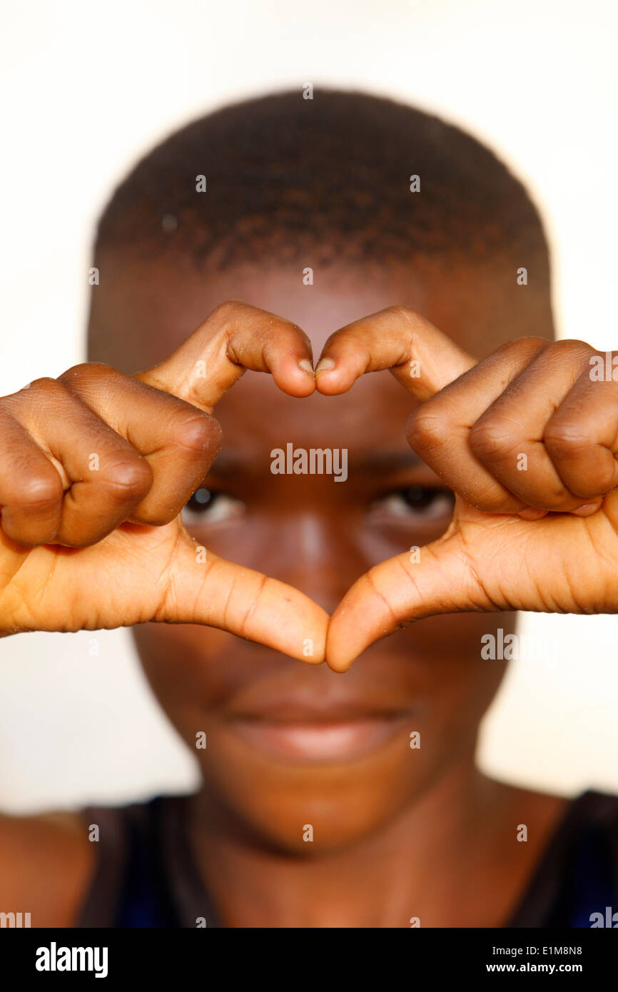 African boy making a heart shape - Stock Image