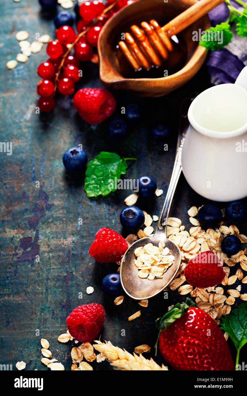 Healthy Breakfast.Oat flake, berries and fresh milk. Health and diet concept - Stock Image