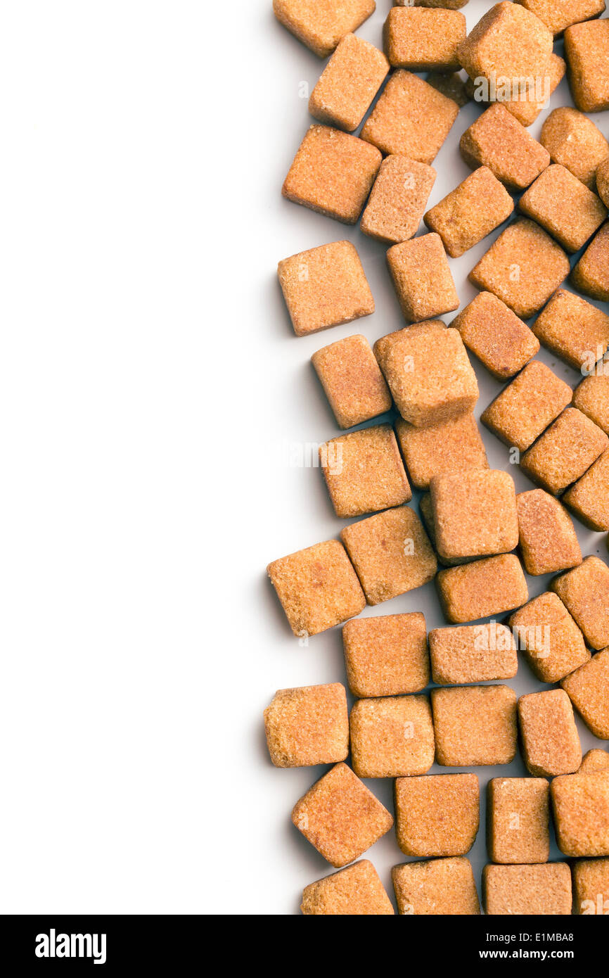 brown sugar cubes on white background - Stock Image