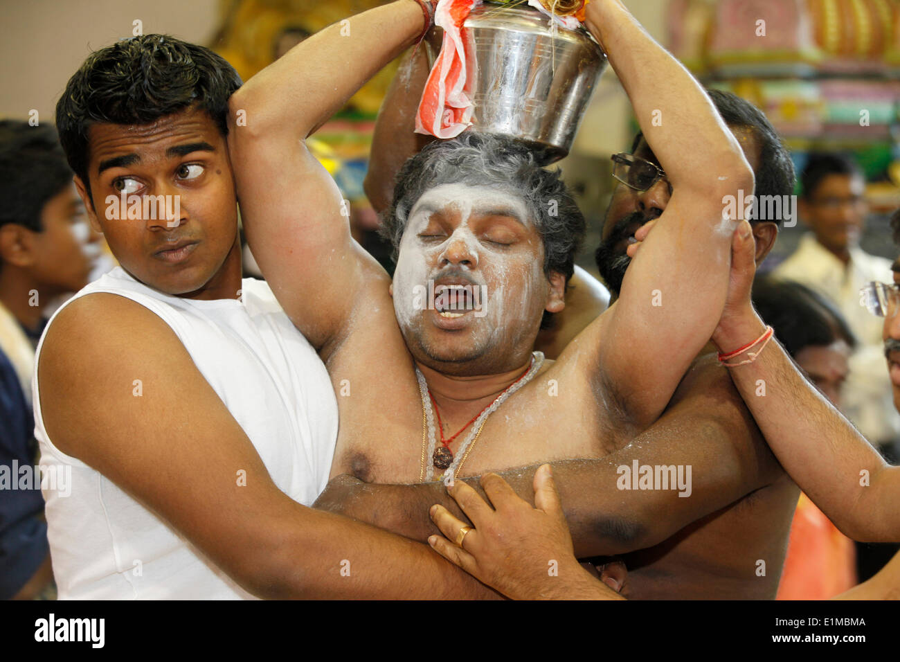 Entranced Hindu devotee restrained - Stock Image