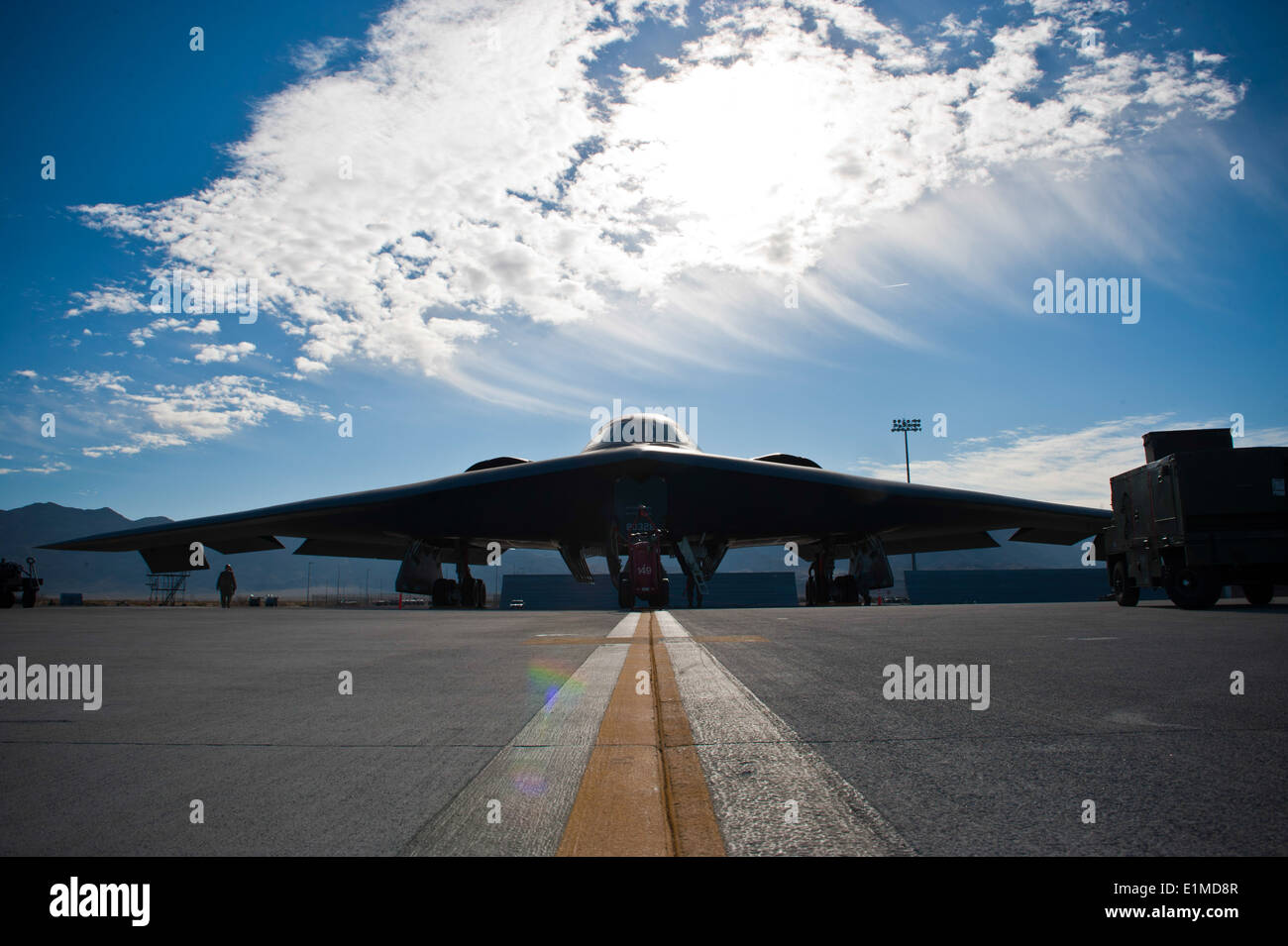 A U.S. Air Force B-2 Spirit aircraft assigned to the 13th Bomb Squadron, Whiteman Air Force Base, Mo., is inspected by ground c - Stock Image