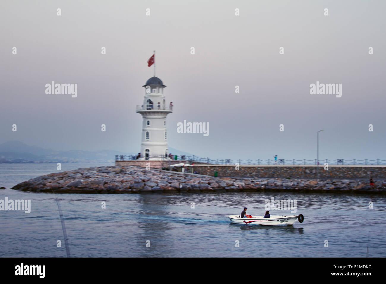Turkey Alanya Night Sunset Light Sea Mediterranean People View Panorama City Dock Harbour Boat Lighthouse Couple Romantic Trip - Stock Image