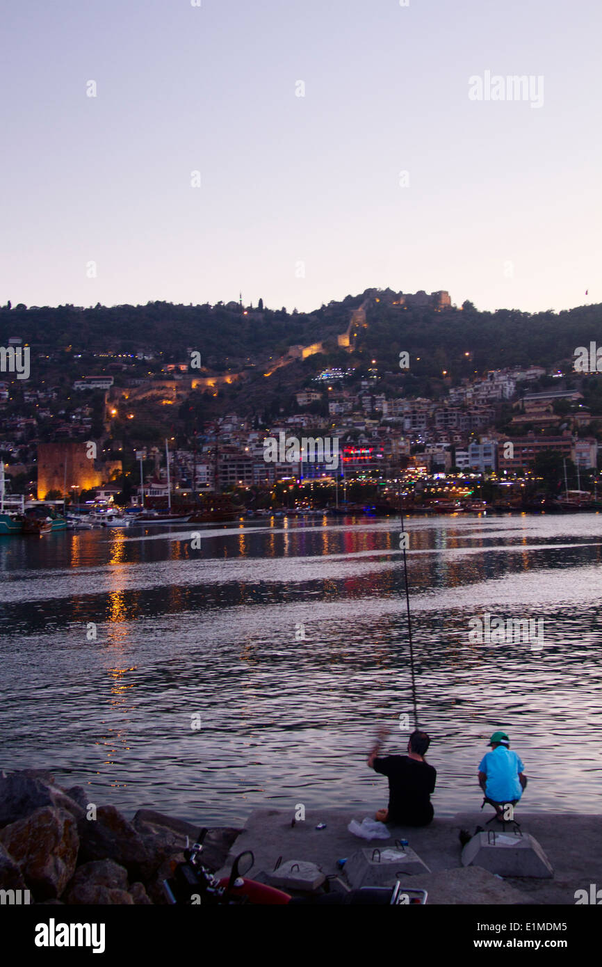 Turkey Alanya Night Sunset Light Sea Mediterranean People View Panorama City Dock Harbour Boat Family Father Son Fisher Child Ca - Stock Image