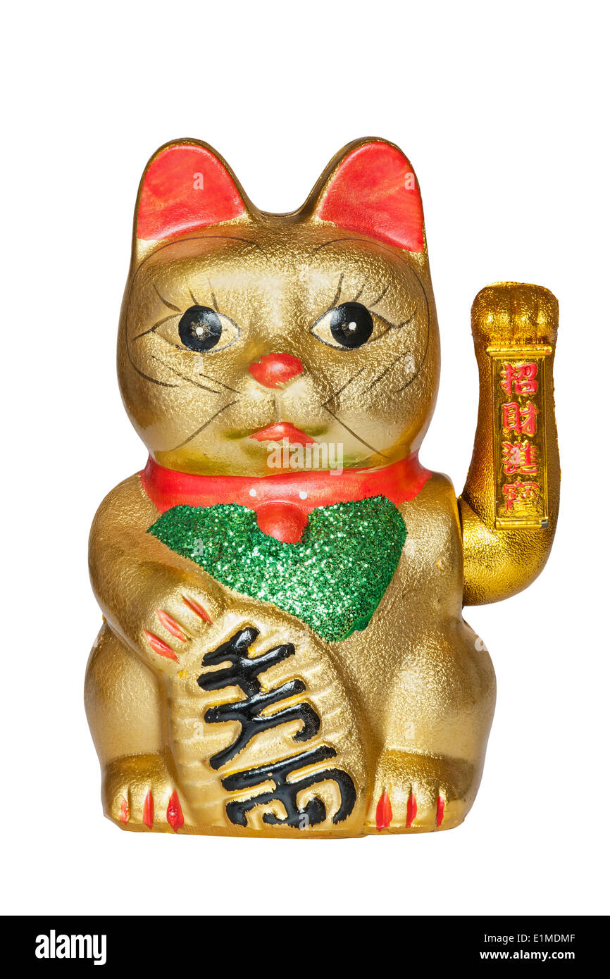 The Maneki Neki Cat is traditional cultural statue from Japan that is believed to bring great wealth and fortune to the owner. - Stock Image