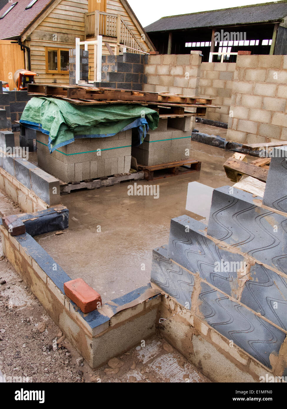 self building house, walls built from thermalite and 10 newton concrete blocks - Stock Image