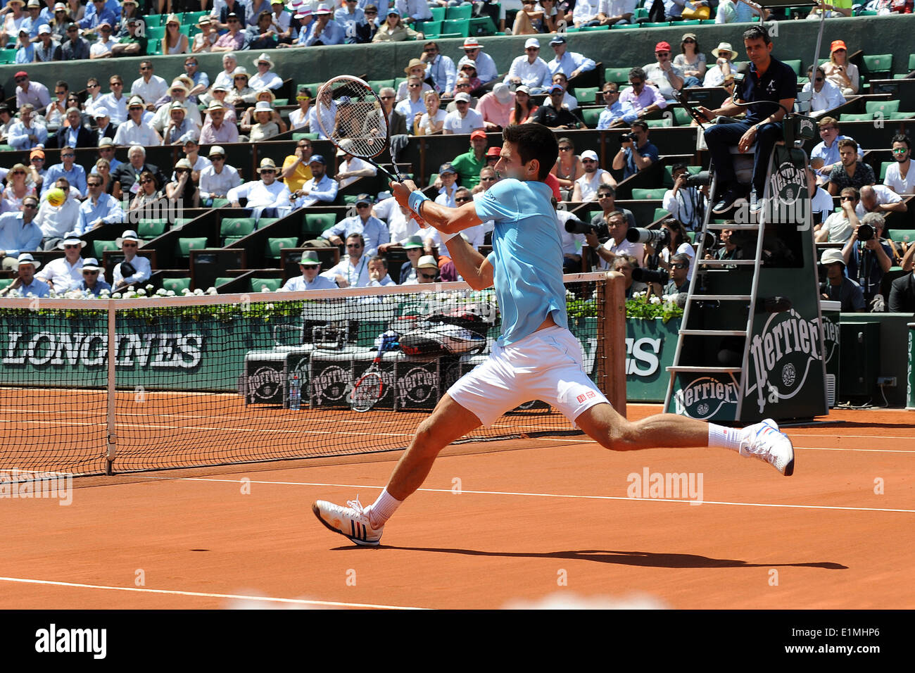 Roland Garros, Paris, France. 06th June, 2014. French Open Tennis Championships. Mens singles semi-final. Novak Djokovic versus Ernest Gulbis. Novak Djokovic with abackhand volley. Djokovic won by a score of 6-3 6-3 3-6 6-3 to reach the final against Nadal. Credit:  Action Plus Sports/Alamy Live News - Stock Image