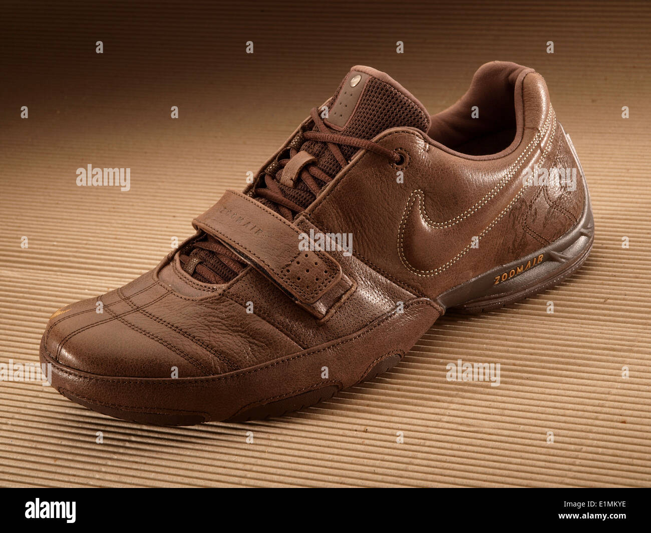 Nike ZoomAir brown sports shoe - Stock Image