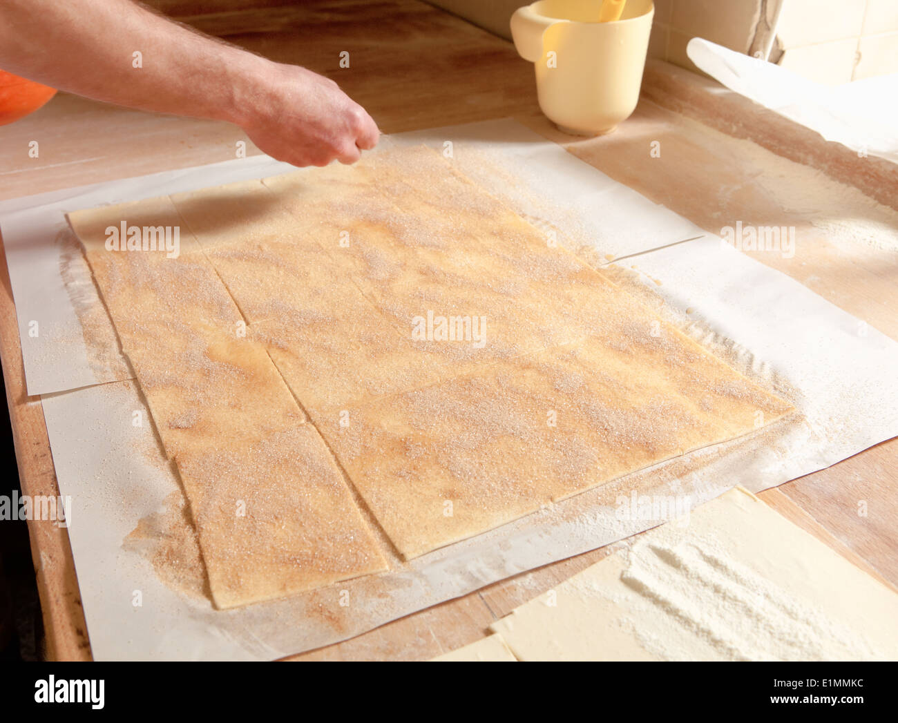 Professional Bakery - Adding Sugar on Top of Pastry - Stock Image