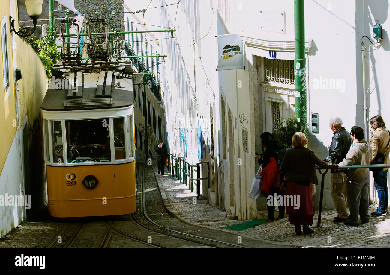 Lisbon's oldest funicular Elevador do Lavra climbing the narrow and steep Calcada do Lavra Lisbon Portugal western Stock Photo