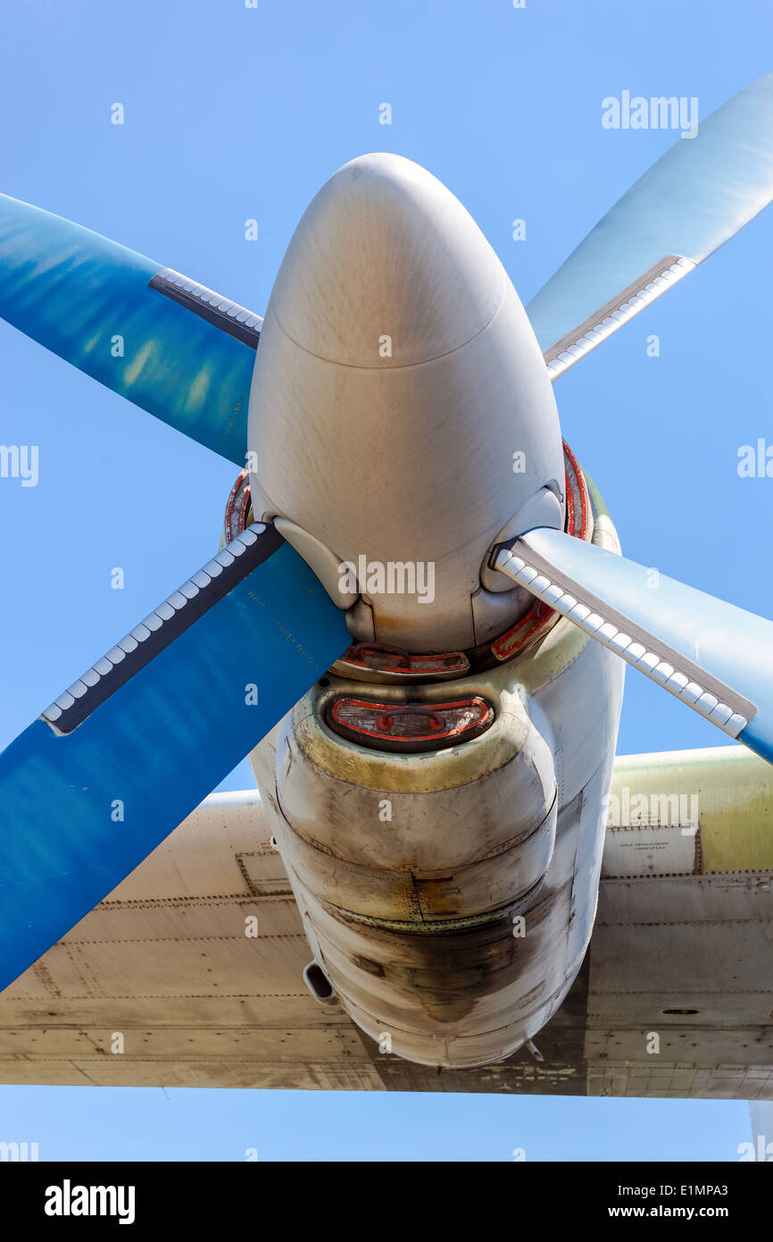 Old russian turboprop aircraft at the abandoned aerodrome in summertime - Stock Image
