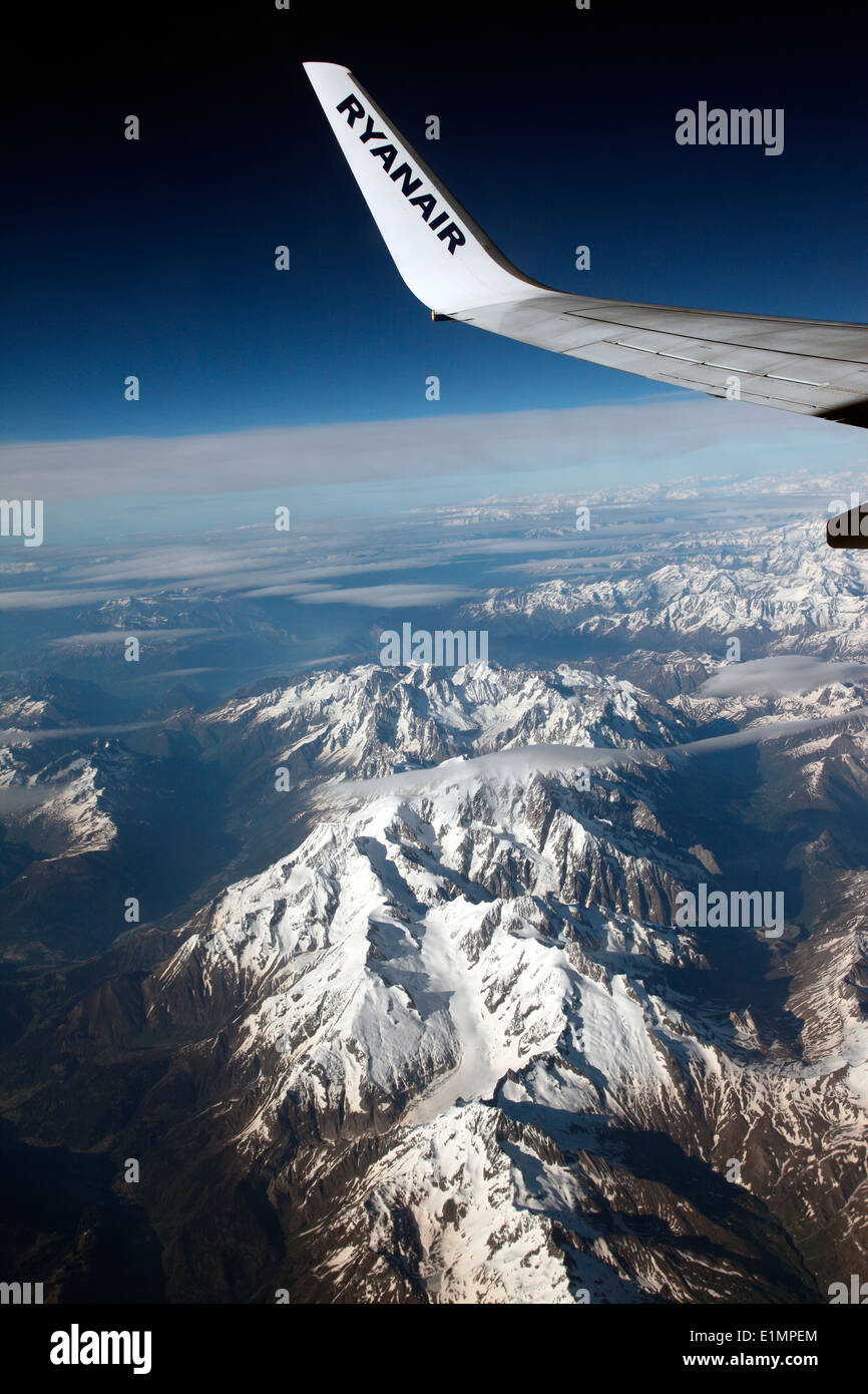 Ryanair aircraft flying over the Alps - Stock Image
