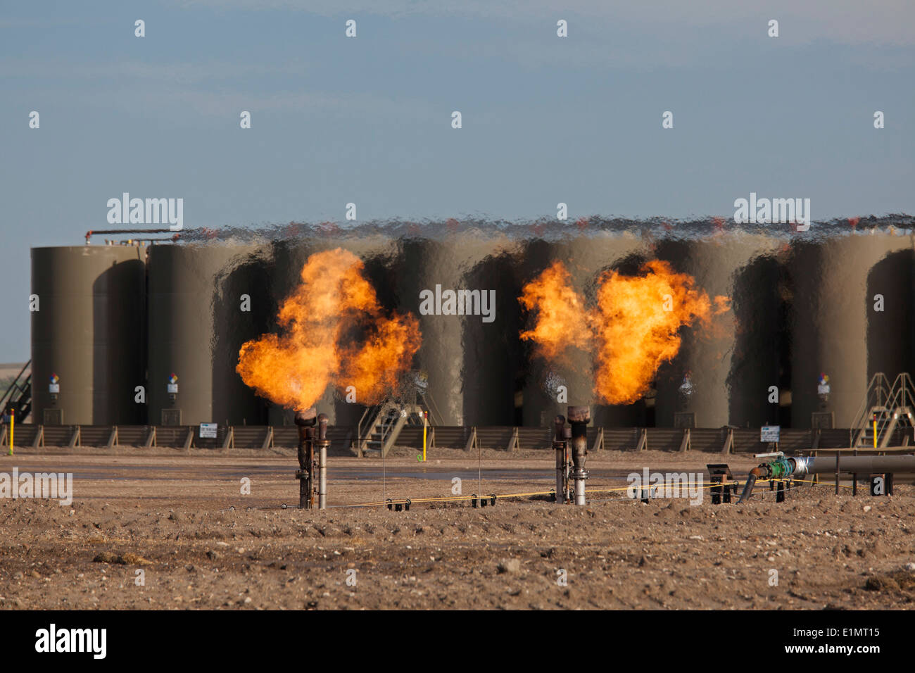 Watford City, North Dakota - Natural gas is flared off as oil is pumped in the Bakken shale formation. - Stock Image