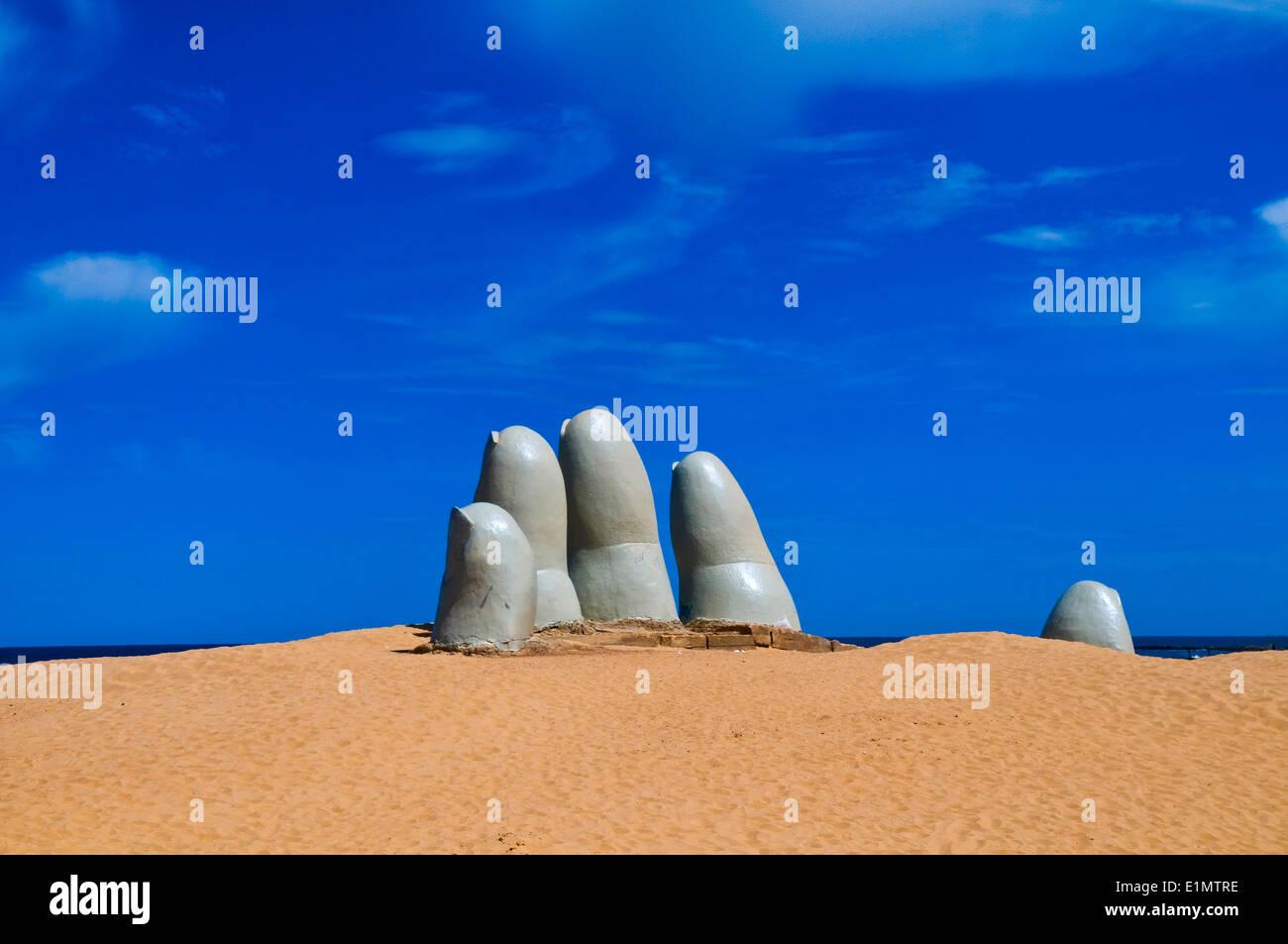 'the Hand' a famous sculpture in 'Punta del este' Uruguay - Stock Image