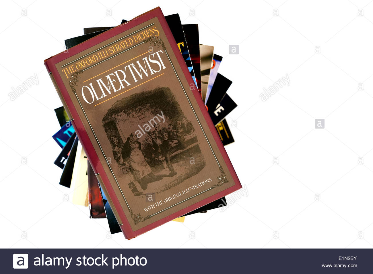 Charles Dickens novel, Oliver Twist, paperback title stacked used books, England - Stock Image