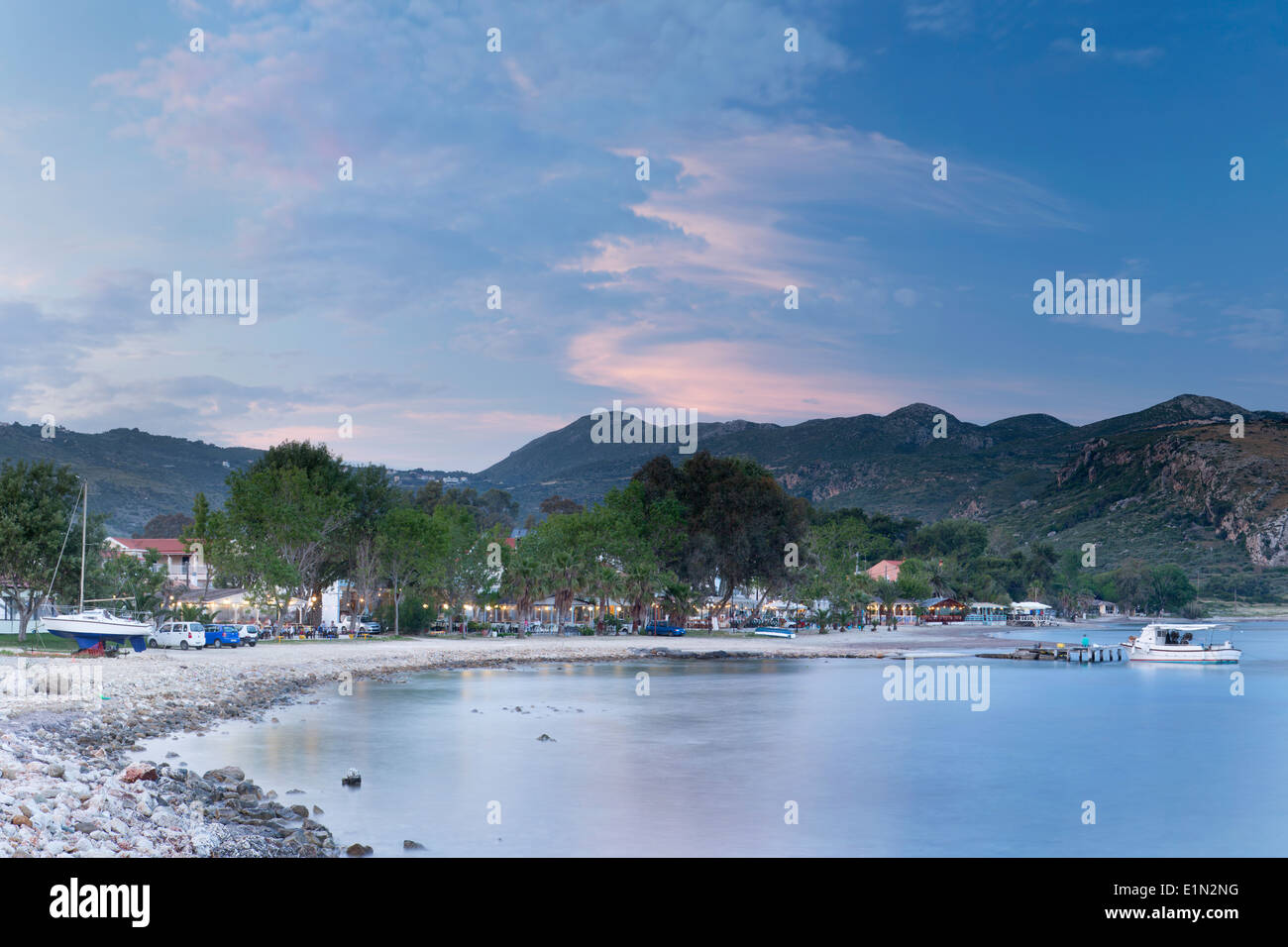 Katelios Harbour, Kefalonia in the evening as the sun sets casting pink clouds in the sky. Stock Photo
