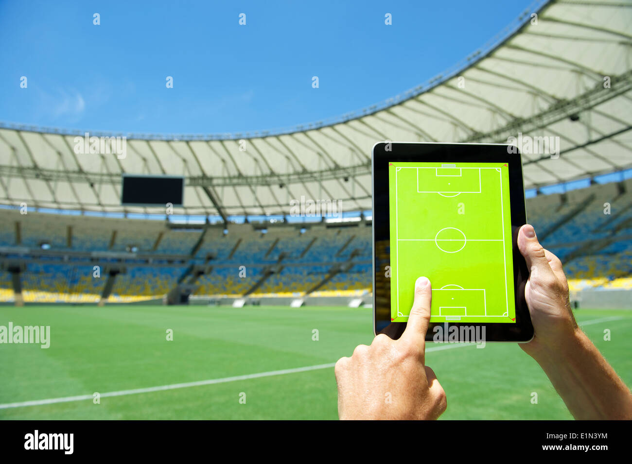 Hands Planning Match On Blank Tactics Board In Front Of Soccer Field At Football Stadium Rio De Janeiro Brazil