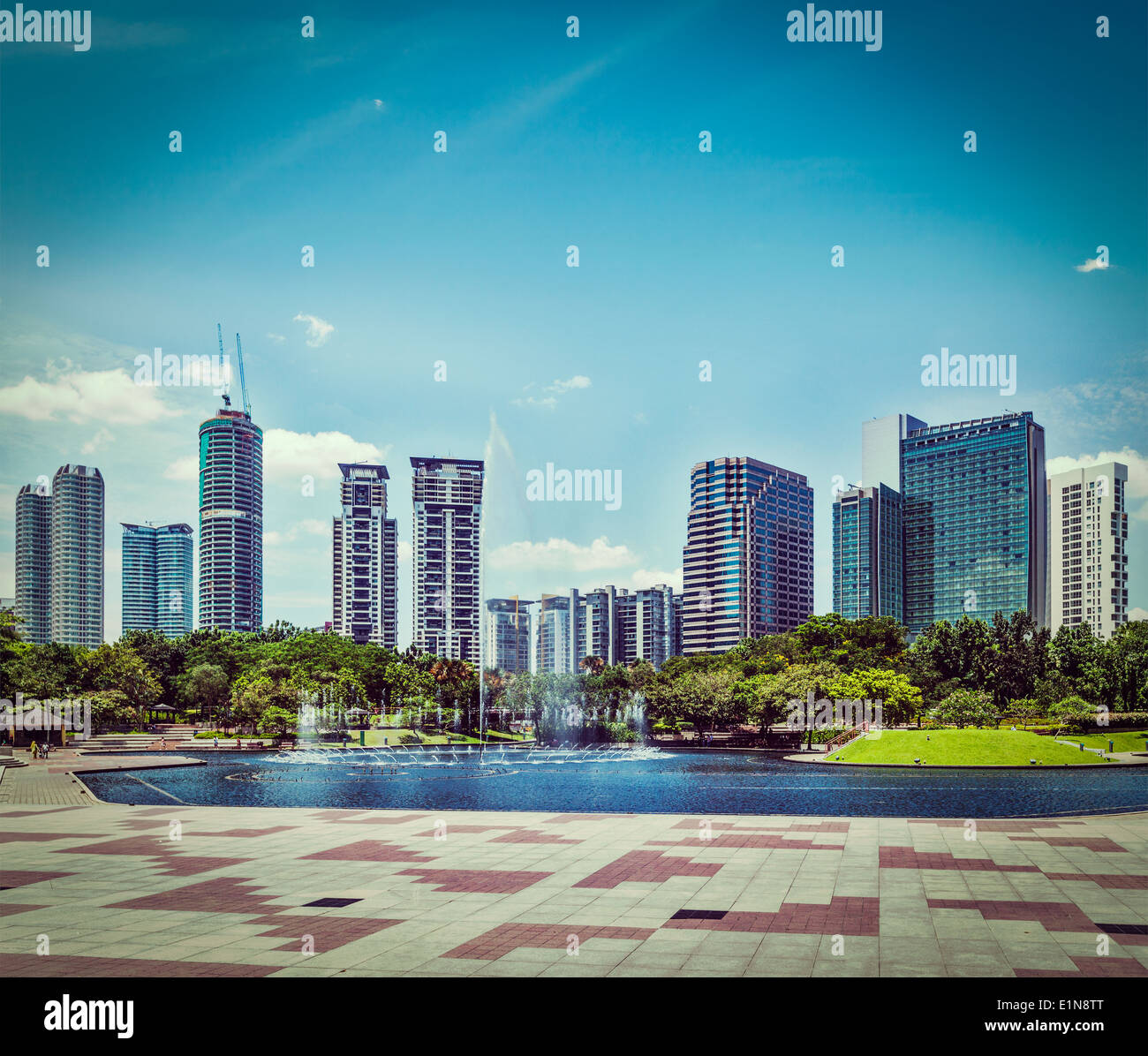 Vintage retro hipster style travel image of skyline of Central Business District of Kuala Lumpur, Malaysia - Stock Image