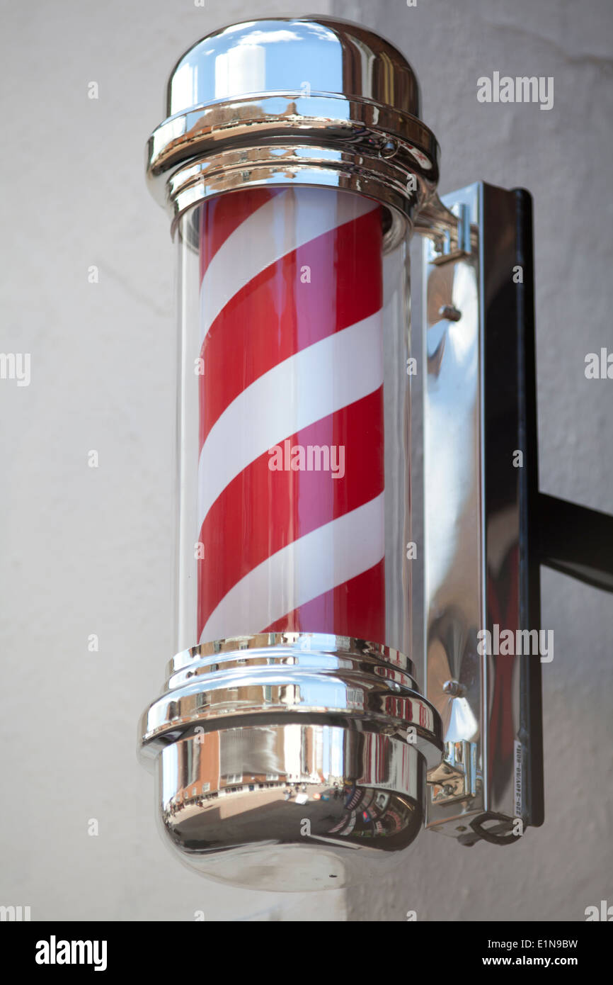 UK, Canterbury, Red and white striped barber's shop pole. - Stock Image