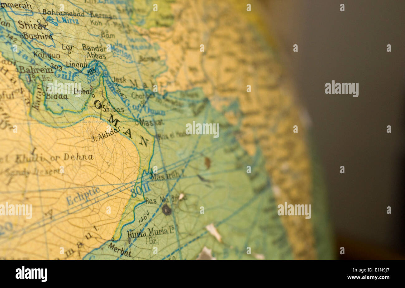 An old map of Oman on an antique globe. - Stock Image