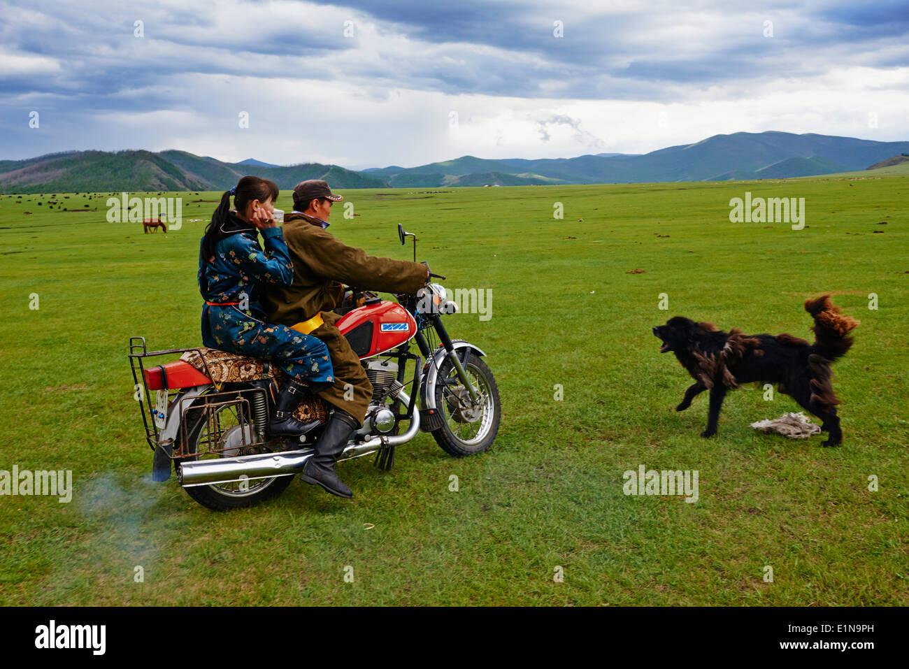 Mongolia, Ovorkhangai province, Okhon valley, Nomad with motorbike - Stock Image