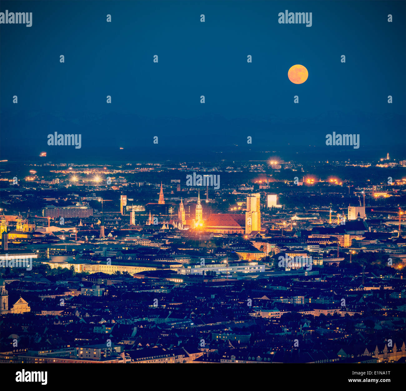 Vintage retro hipster style travel image of night aerial view of Munich from Olympiaturm (Olympic Tower). Munich, Germany - Stock Image