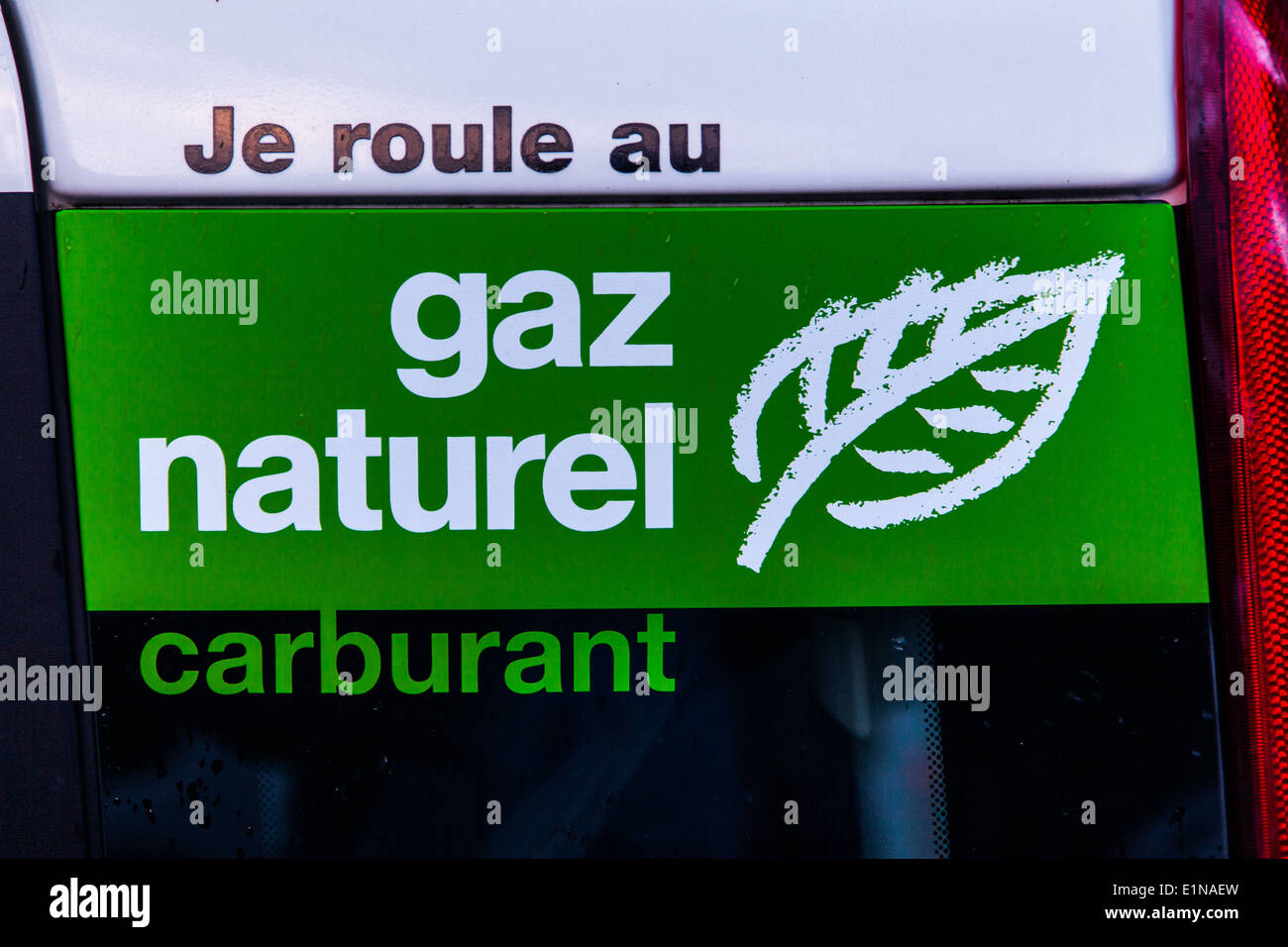 French language sign on a car telling it is powered by natural gas, Switzerland - Stock Image