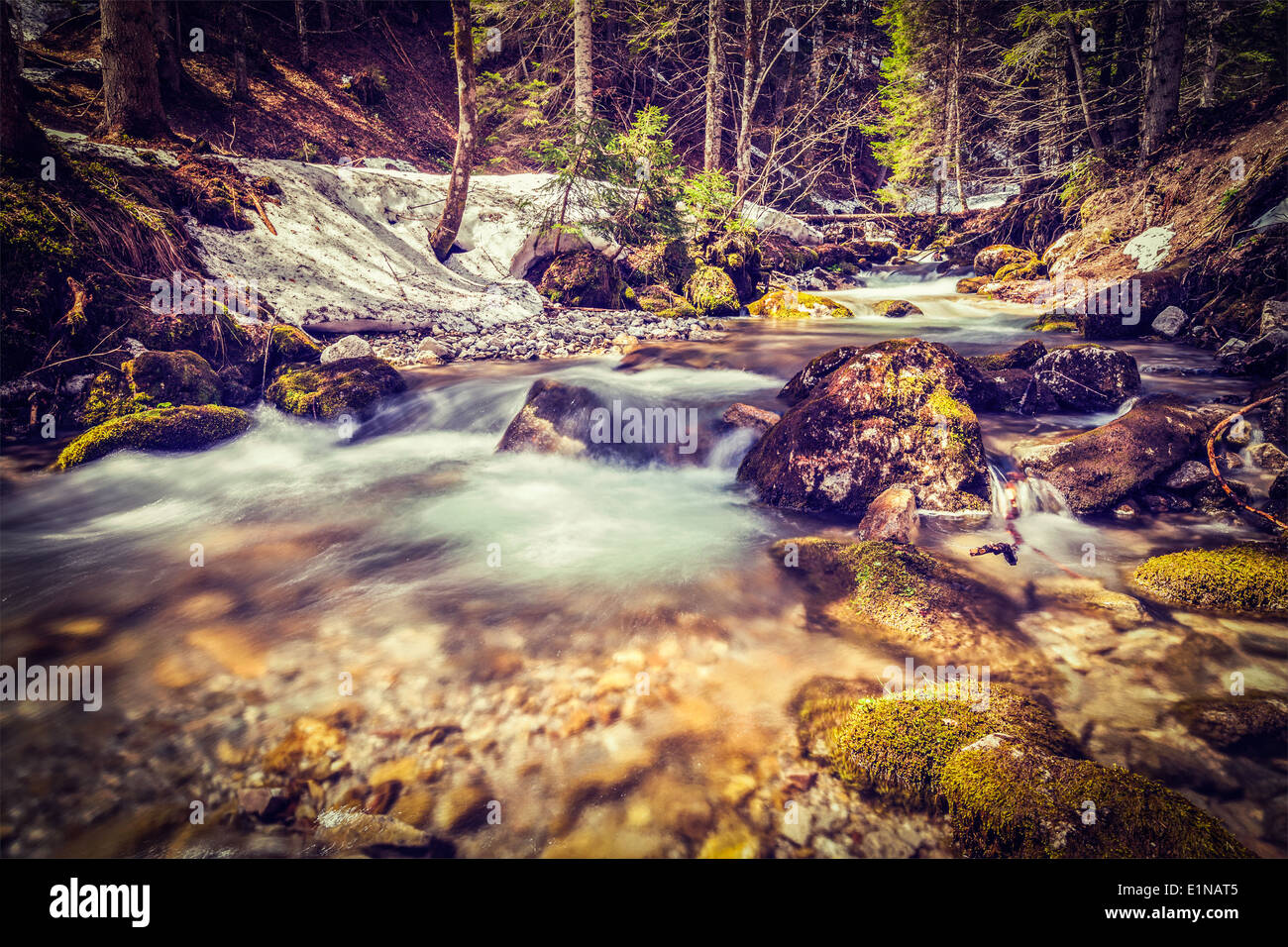 Vintage retro hipster style travel image of Cascade of Sibli-Wasserfall. Rottach-Egern, Bavaria, Germany - Stock Image