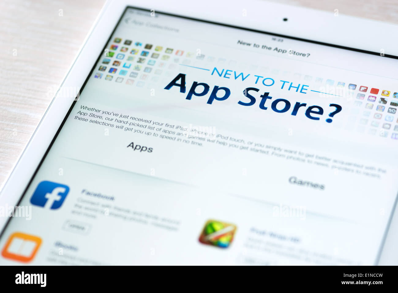 App Store features information page with popular apps on brand new Apple iPad Air - Stock Image