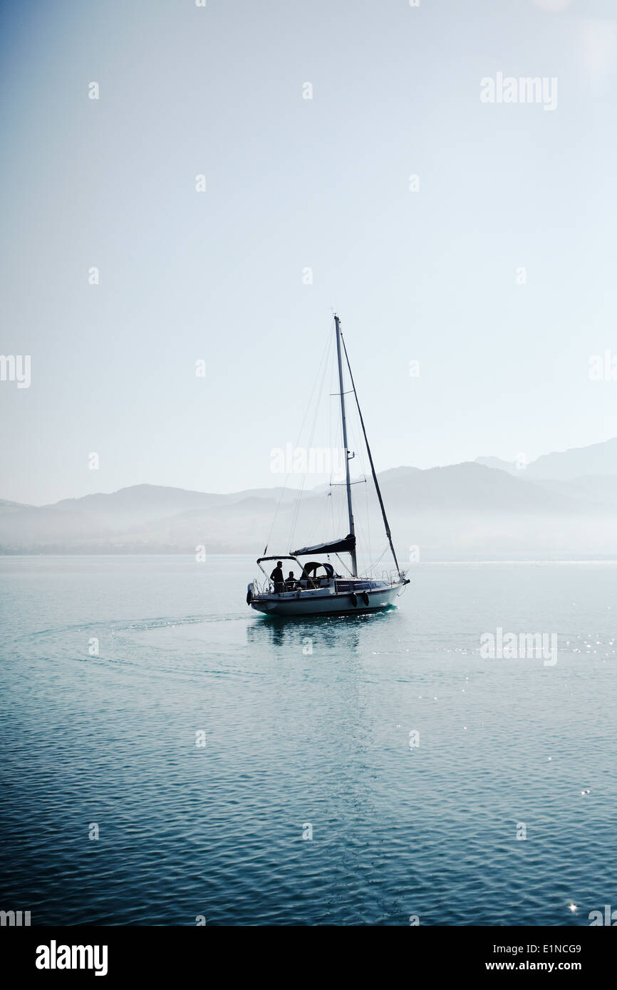 Yacht at the lake Attersee, Salzkamergut, Upperaustria, Austria in the early morning - Stock Image