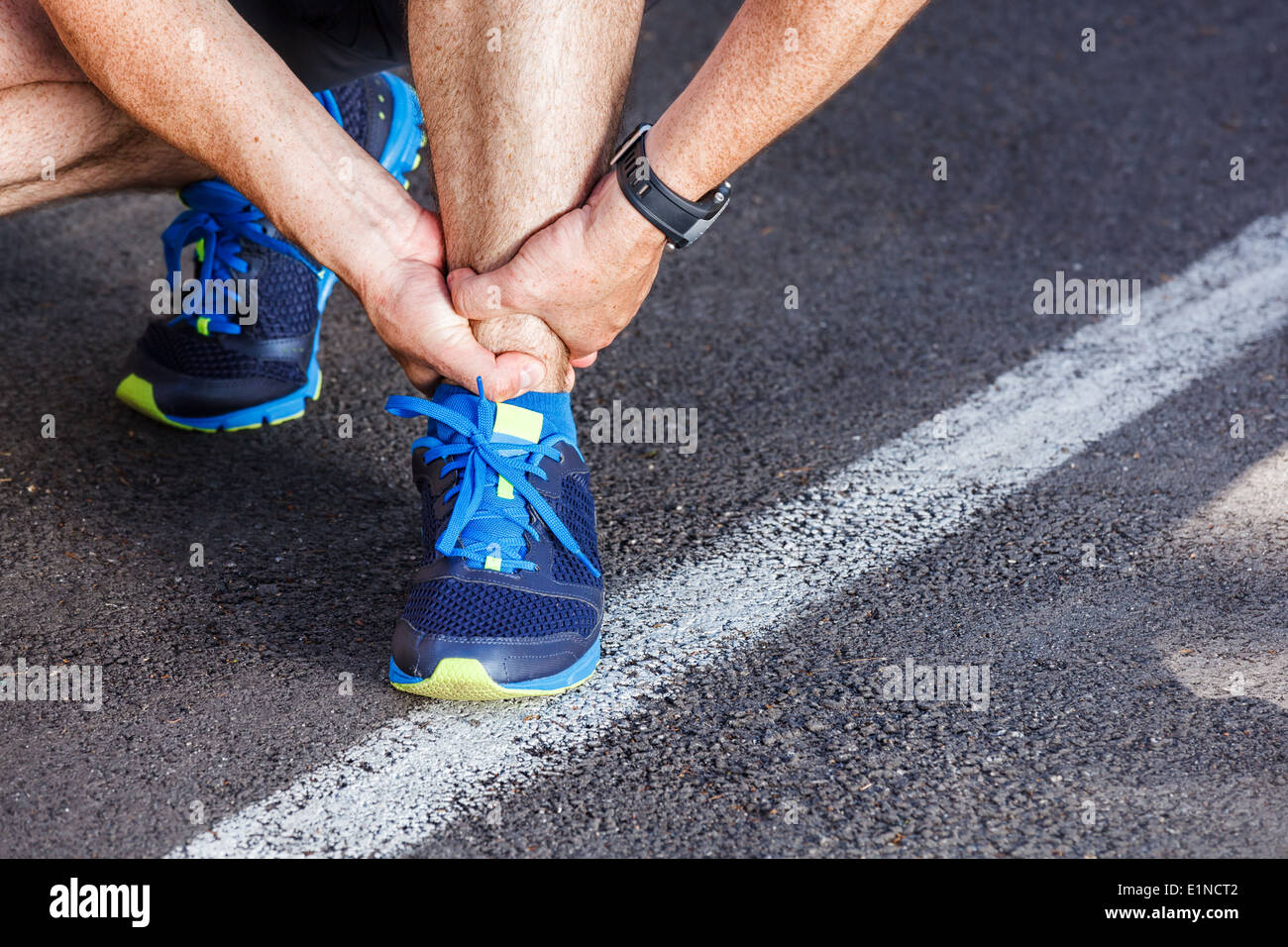 Broken twisted ankle - running sport injury. - Stock Image