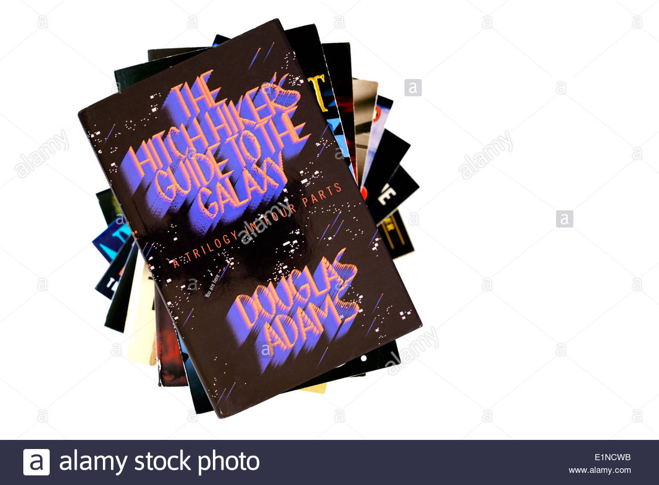 Douglas Adams hardback title The Hitchhicker's Guide To The Galaxy, stacked used books, England - Stock Image