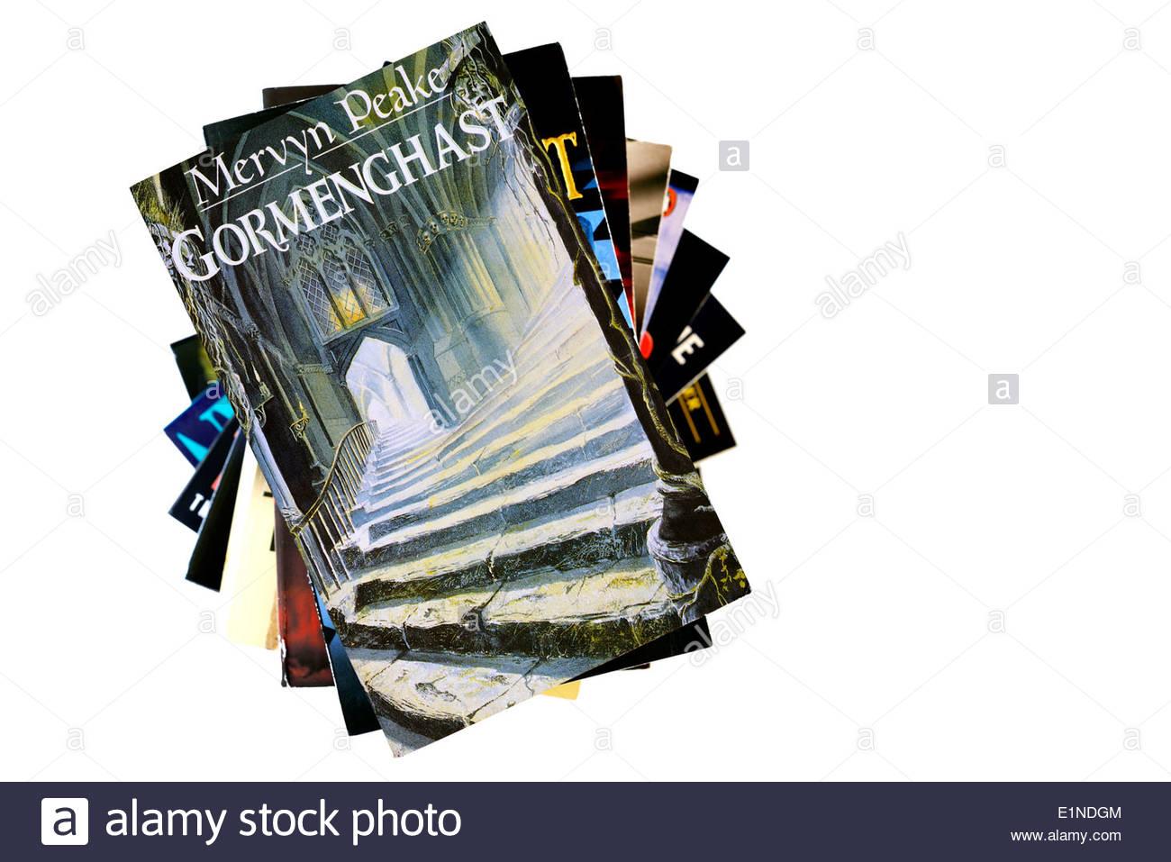 Mervyn Peake paperback title Gormenghast,  stacked used books, England - Stock Image
