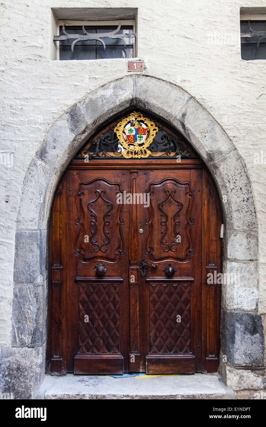 Double doorway in an arched entry of a building in Sion, Switzerland Stock Photo