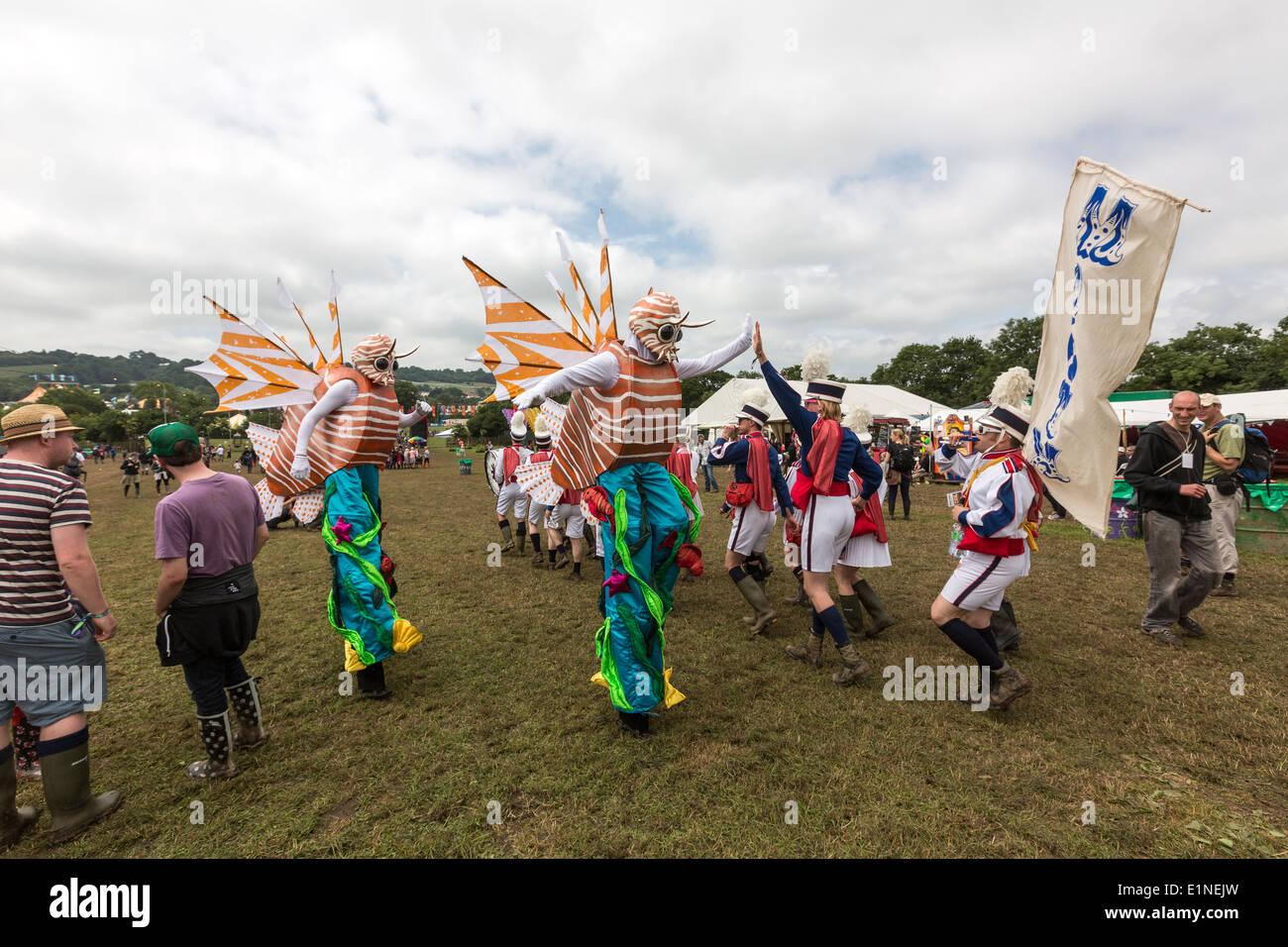Parade of costumed people Glastonbury Festival 2013 - Stock Image