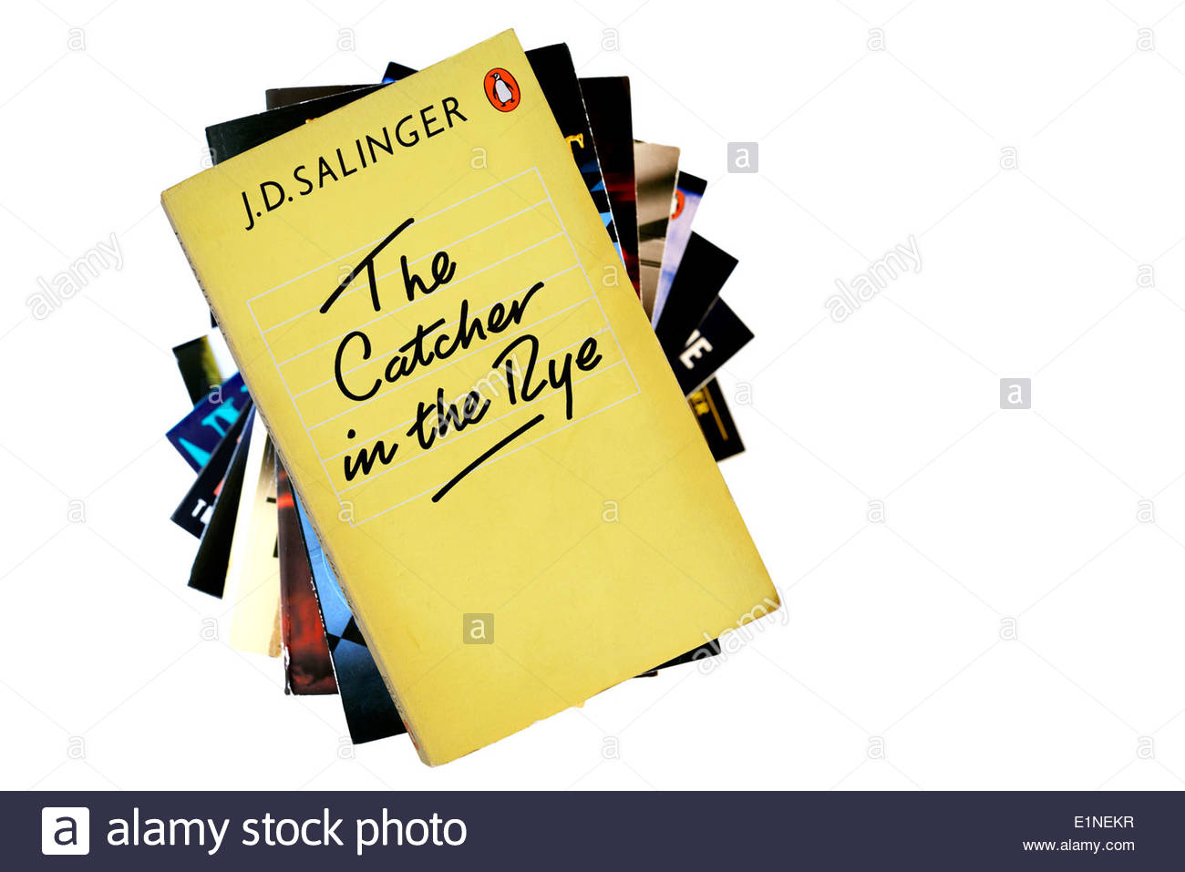 The Catcher in the Rye, J D Salinger paperback title, stacked used books, England - Stock Image