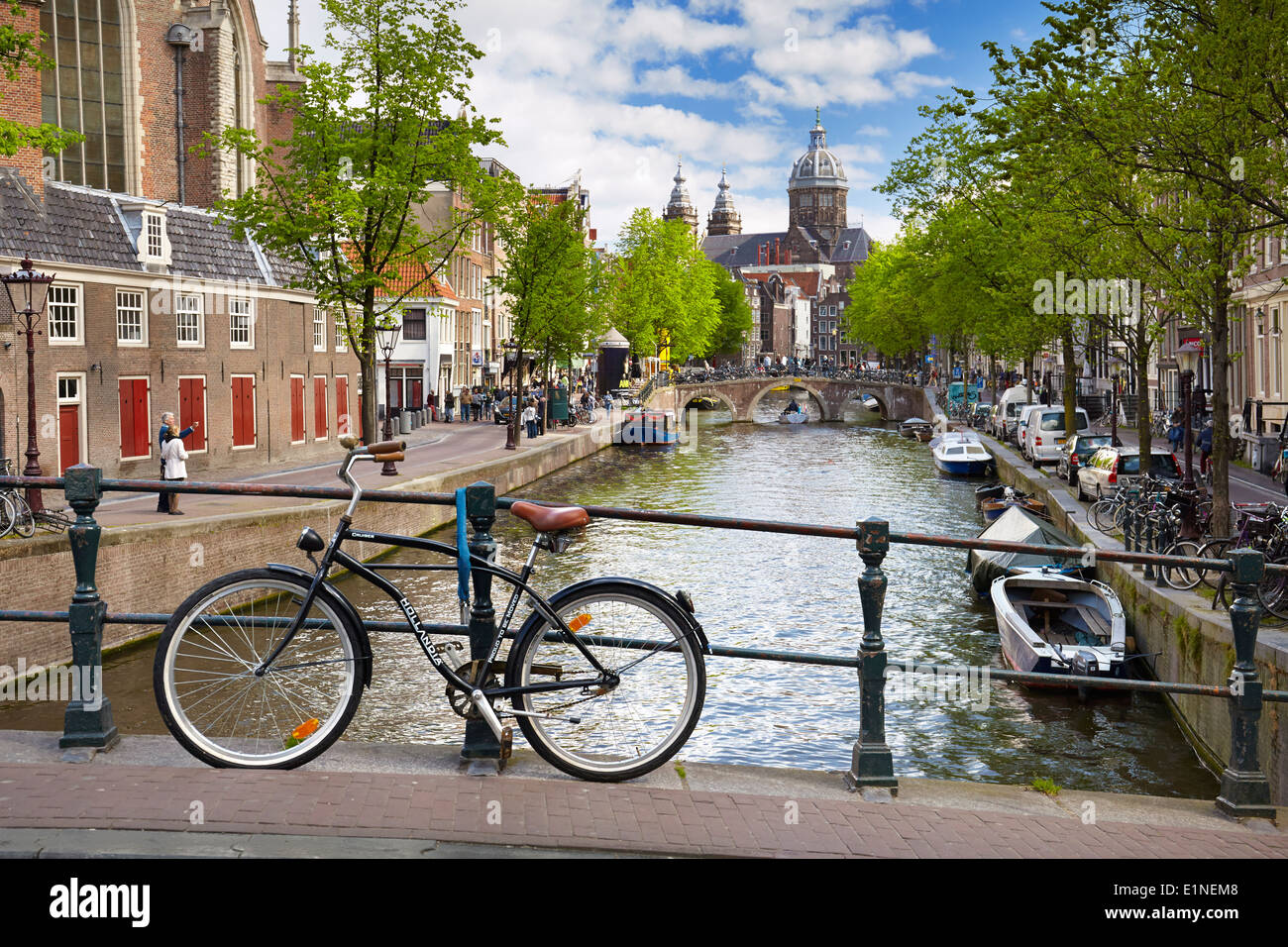 Bicycle on Amsterdam canal, Holland, Netherlands - Stock Image