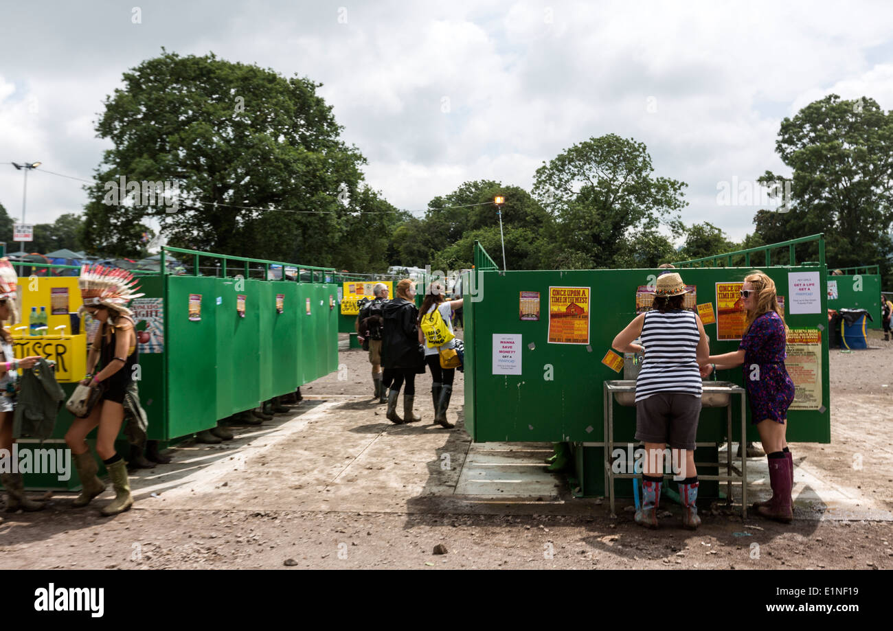 Washing hand in the open loo Glastonbury Festival 2013 - Stock Image