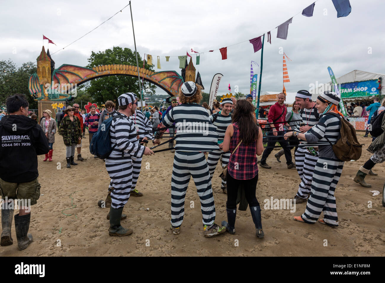 Funny people dressed as prisoners  Glastonbury Festival 2013 - Stock Image