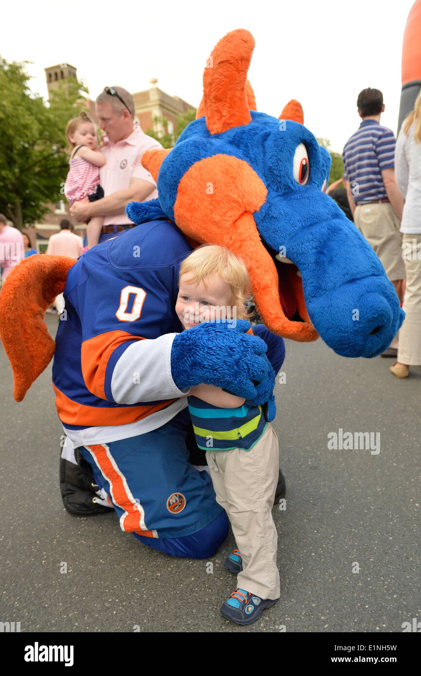 Garden City, New York, U.S. - June 6, 2014 - OLIVER PAPP, 18-months-old, of Garden City, hugs SPARKY THE DRAGON, Stock Photo