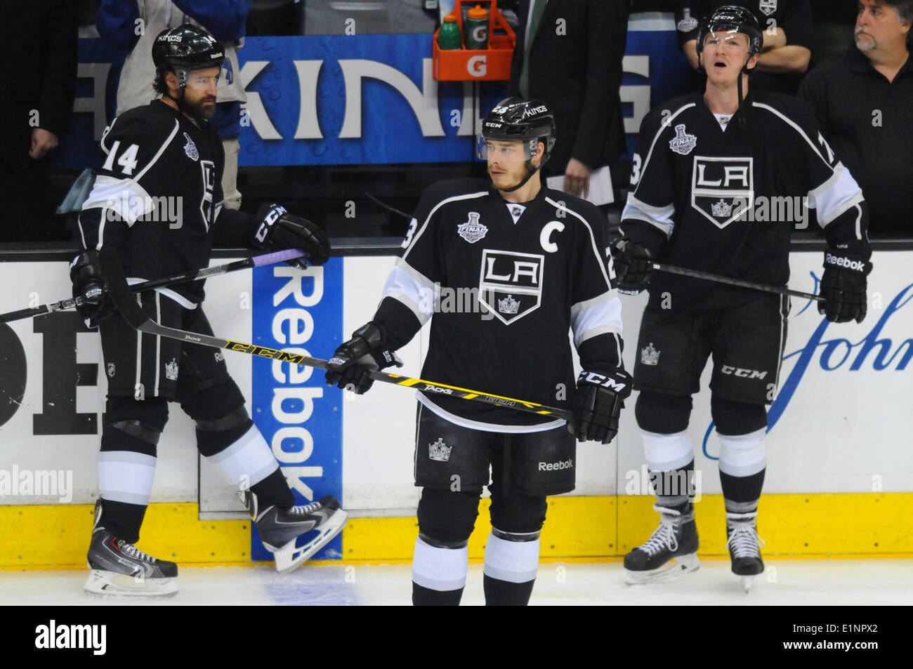 Staples Center, Los Angeles, California, USA. 07th June, 2014. Los Angeles Kings Right Wing Justin Williams (14) [2150], Los Angeles Kings Right Wing Dustin Brown (23) [2289], and Los Angeles Kings Right Wing Tyler Toffoli (73) [8400] during pre-skate prior to game 2 of the Stanley Cup Final between the New York Rangers and the Los Angeles Kings at Staples Center in Los Angeles, CA. - Stock Image