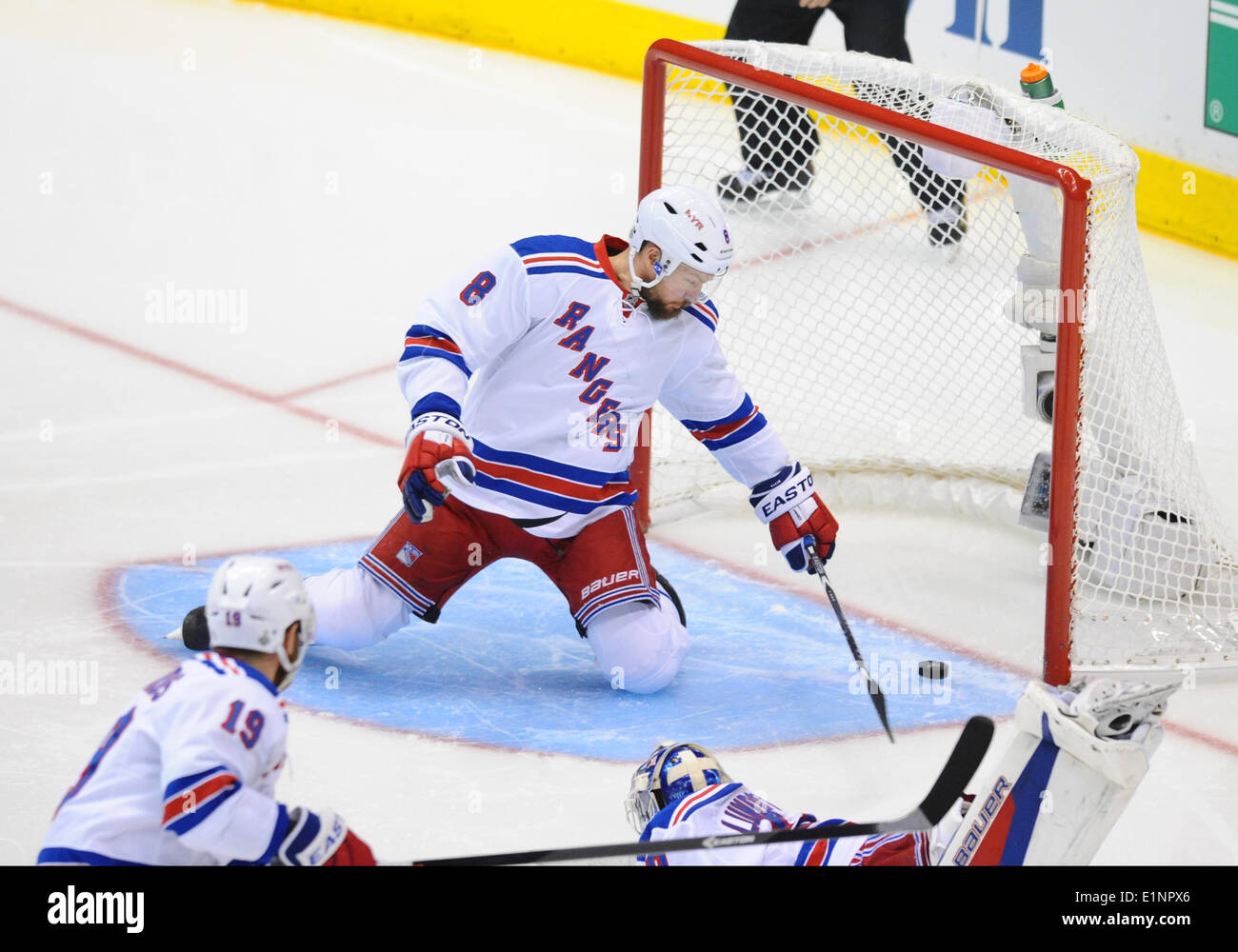 Staples Center, Los Angeles, California, USA. 07th June, 2014. New York Rangers Defenseman Kevin Klein (8) [3515] attempts to cover the net as New York Rangers Goalie Henrik Lundqvist (30) [2585] is knocked out of the crease and gives up a goal to the Kings during game 2 of the Stanley Cup Final between the New York Rangers and the Los Angeles Kings at Staples Center in Los Angeles, CA. - Stock Image