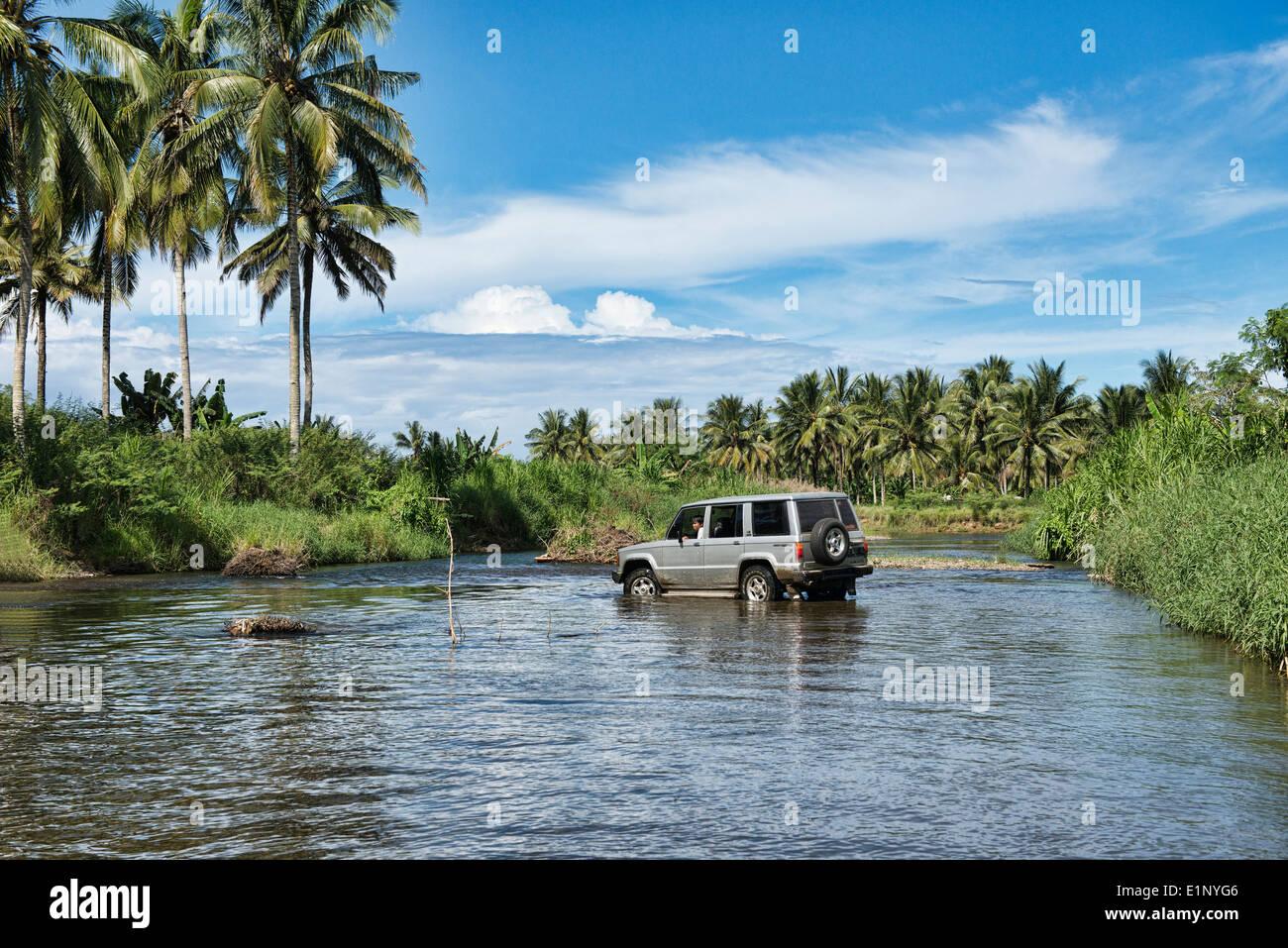 jeep navigating river crossing to Sukamade Beach, Meru Betiri National Park, Java, Indonesia - Stock Image