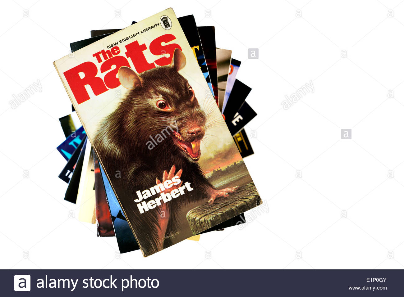 James Herbert horror novel The Rats, paperback title stacked used books, England - Stock Image