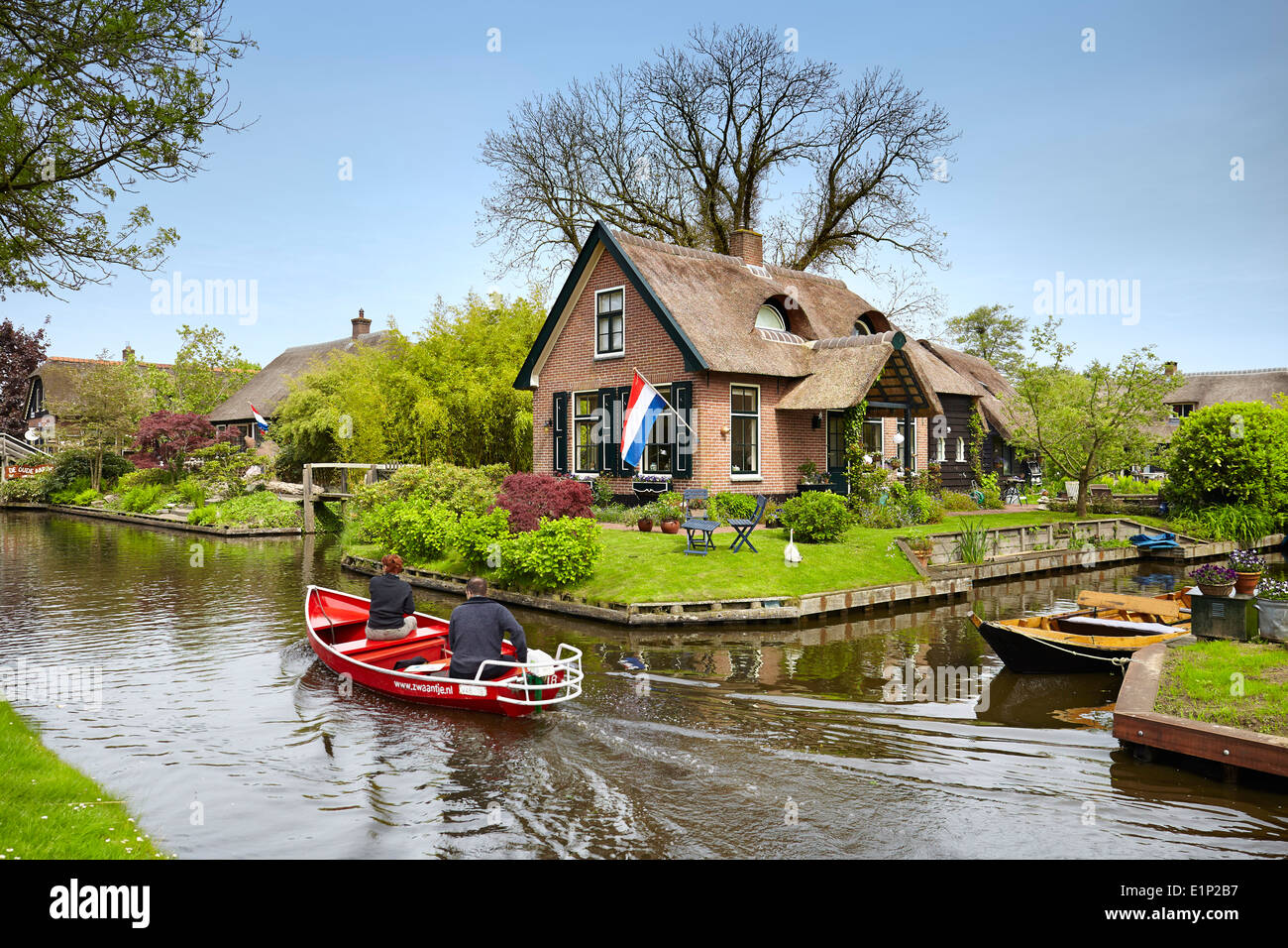 Boat on the canals, local transport, Giethoorn village - Holland Netherlands - Stock Image
