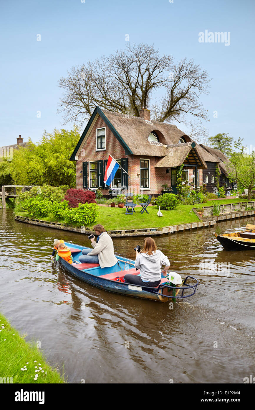 Tourists on the boat sail on the canal, Giethoorn village - Holland Netherlands - Stock Image