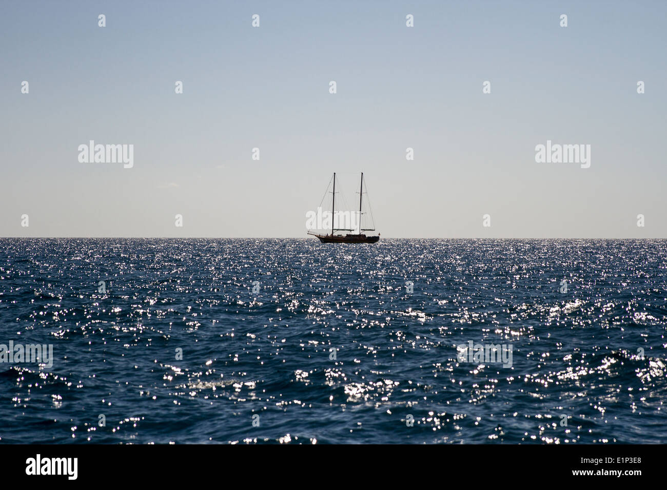 Sail boat on the Horizon - Stock Image