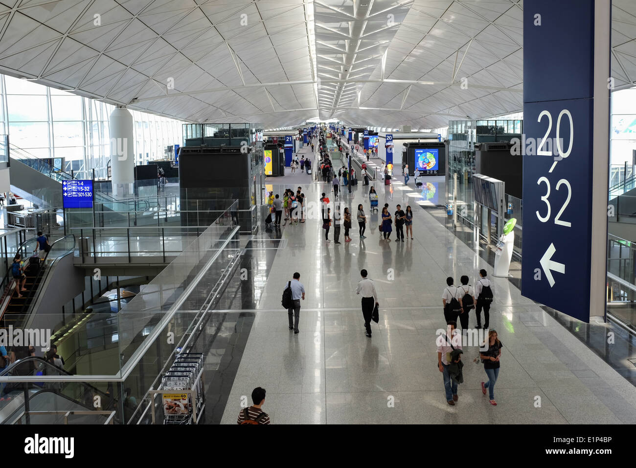 Departure area of Hong Kong International Airport located on the island of Chek Lap Kok. Stock Photo