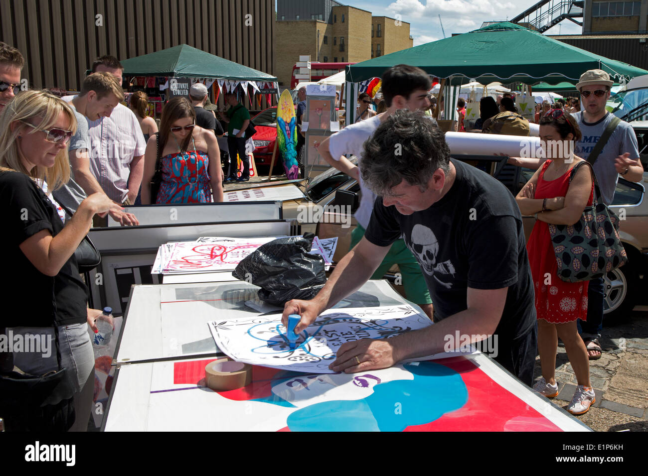 artist pure evil signing prints at the vauxhall art car boot fair