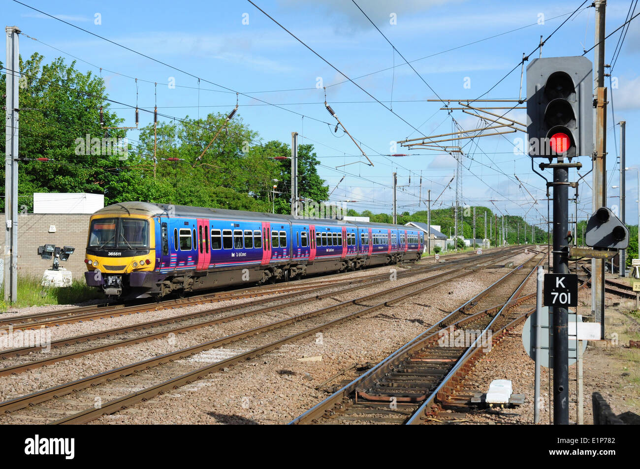 Class 365 DMU heads north from Hitchin, Hertfordshire, England, UK - Stock Image