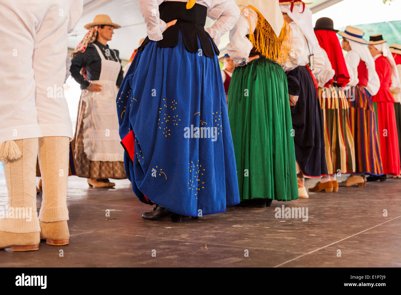 Canarian people celebrate their national day dressed in traditional costumes and dancing in the plaza in Alcala, Tenerife, - Stock Image